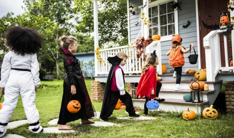 Trick-or-Treat with Blue Buckets for Autism Awareness